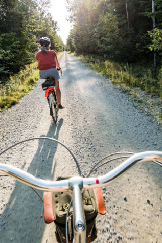 Pedaling where trains once chugged past on a section of the 85-mile, multi-use trail near Cherryfield. The Down East Sunrise Trail offers off-road passage in all seasons for cyclists, hikers, skiers, and people on snowshoes, horseback, snowmobiles, or ATVs.