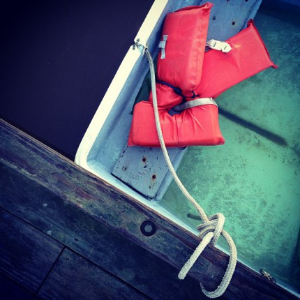Birdseye View of Boat with Red Life Jacket