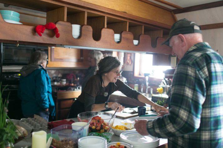 Jillian serving breakfast on the sunbeam