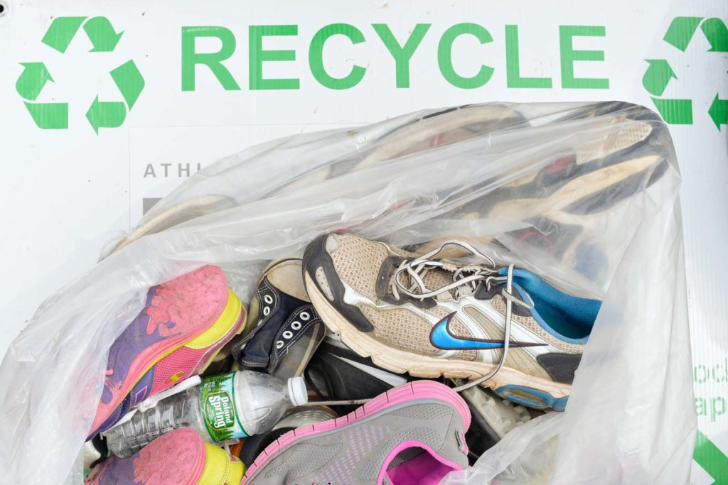 f333b495a397be Nike collects unwanted running shoes on race day and recycles them into a  variety of products through its Reuse-A-Shoe program.