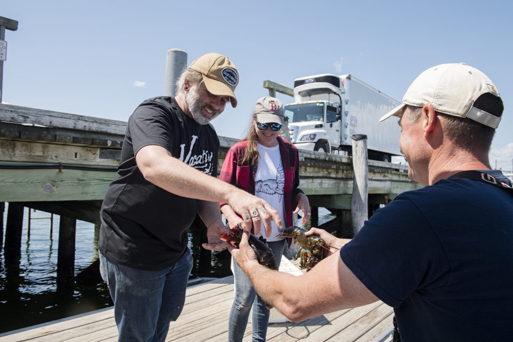 The owners of Peter Trout's Tavern picking up seafood from the dock