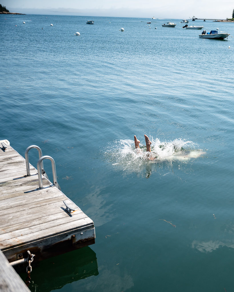 A refreshing dive off the dock into Tenants Harbor, Maine.