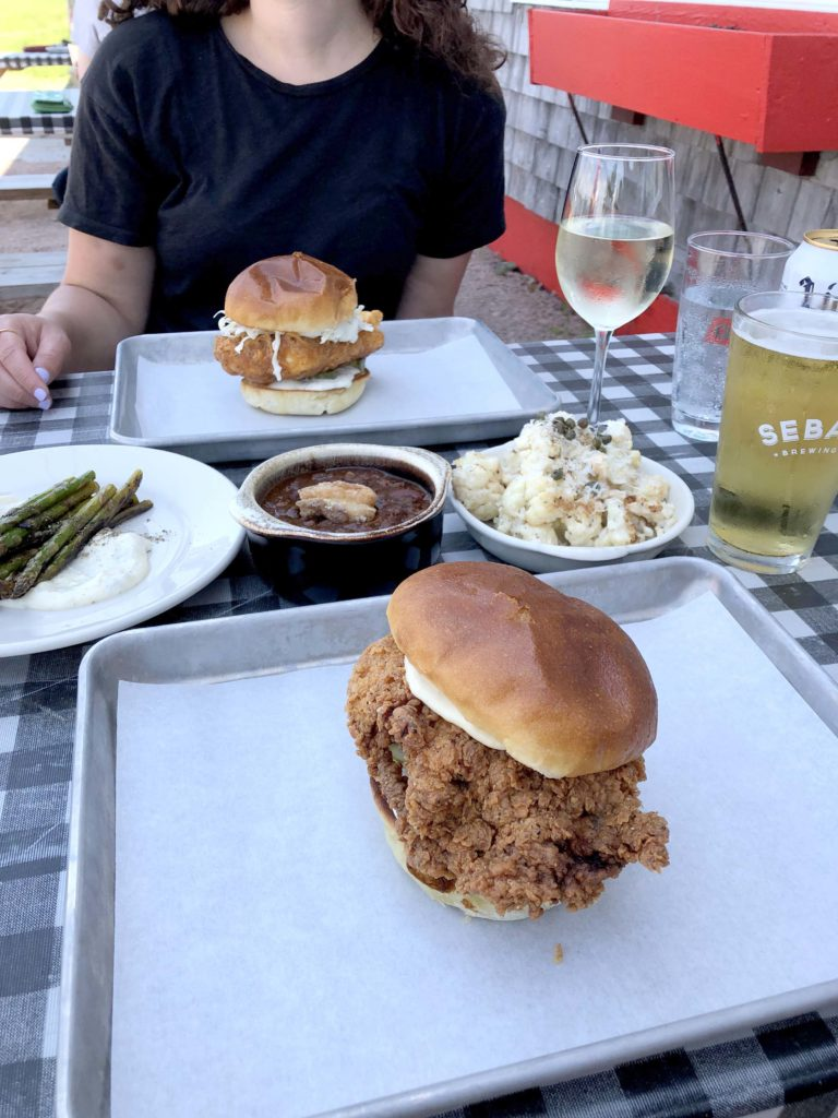 Peter Trout's Tavern and Inn in Southwest Harbor, MDI serves Southern staples like a Nashville-style hot fried chicken sandwich.