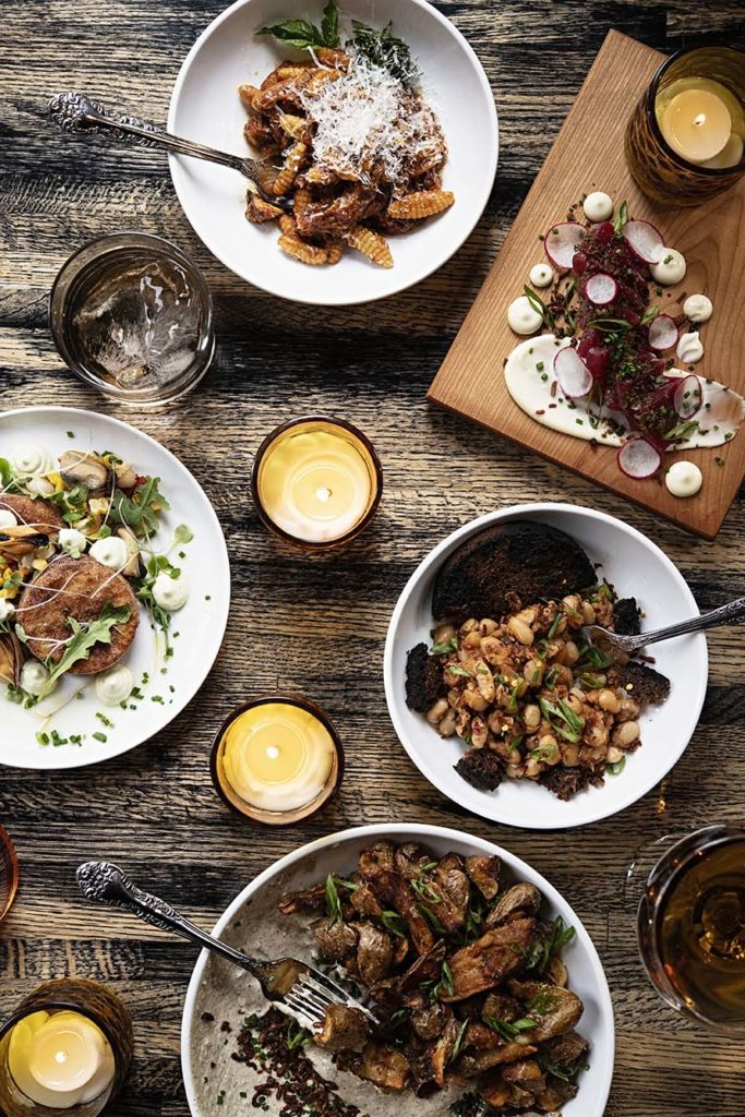 A spread of small plates at Broken Arrow features updated Maine classics with Italian influences.