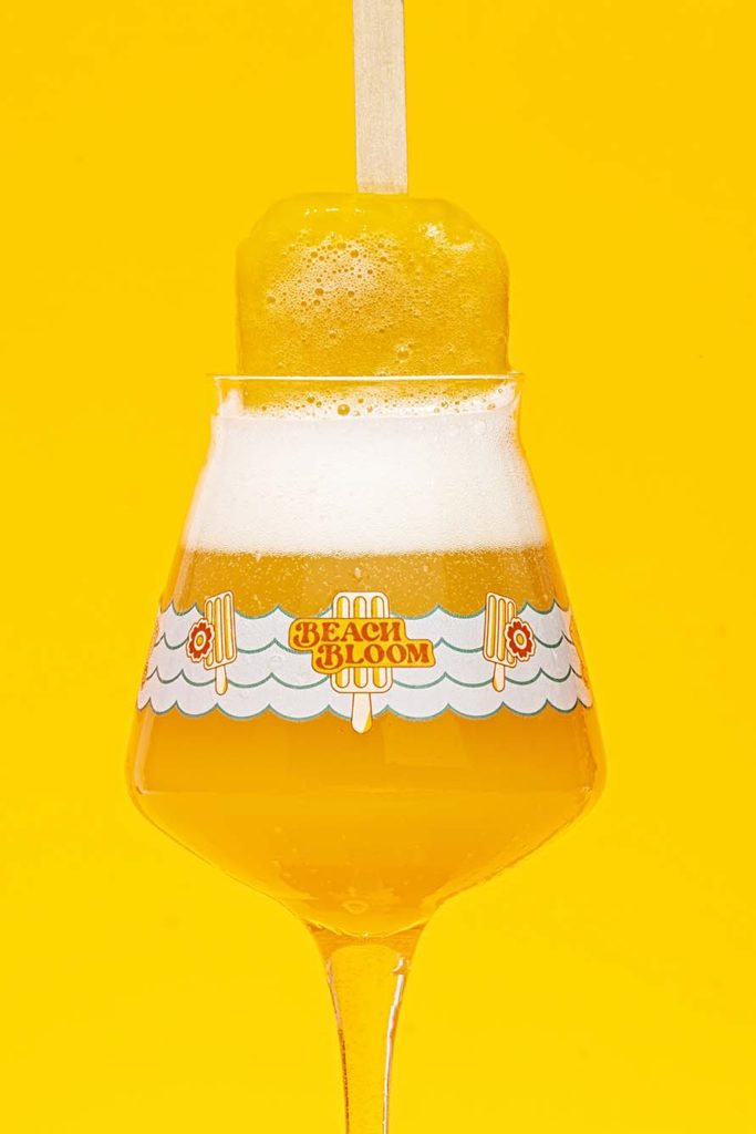 Beach Bloom Dreamsicle Double IPA brewed with orange zest, tangerine, and Madagascar vanilla.