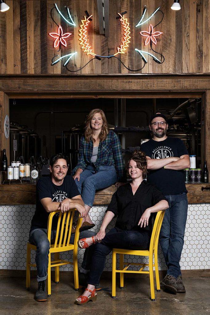 Owners Zack Page, Melissa Page, Katie Bonadies, and Nick Bonadies in the belleflower brewery's tasting room.