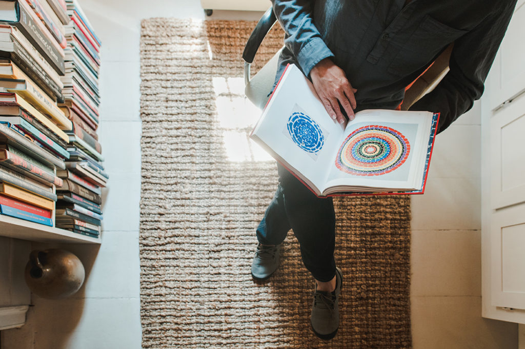 A book of Alma Thomas' colorful abstract paintings in the library, in their Belfast home.